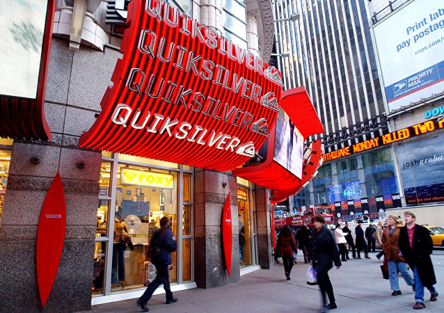 People walk by the new Quiksilver store in New York's Times Square. (File)
