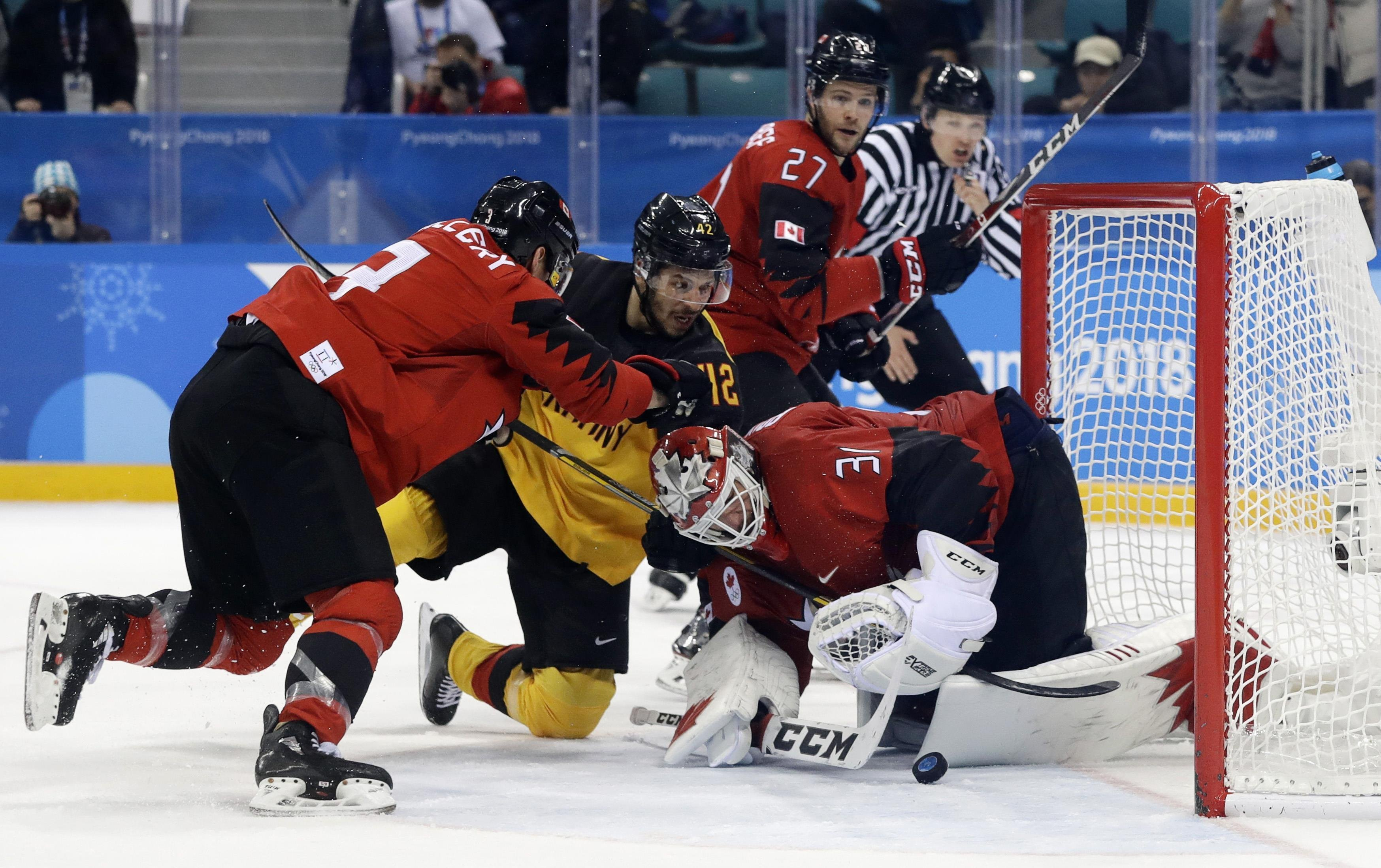 Ice Hockey - Pyeongchang 2018 Winter Olympics - Men Semifinal Match - Canada v Germany - Gangneung Hockey Centre, Gangneung, South Korea - February 23, 2018 - Yasin Ehliz of Germany fails in his attempt to score against goalie Kevin Poulin of Canada