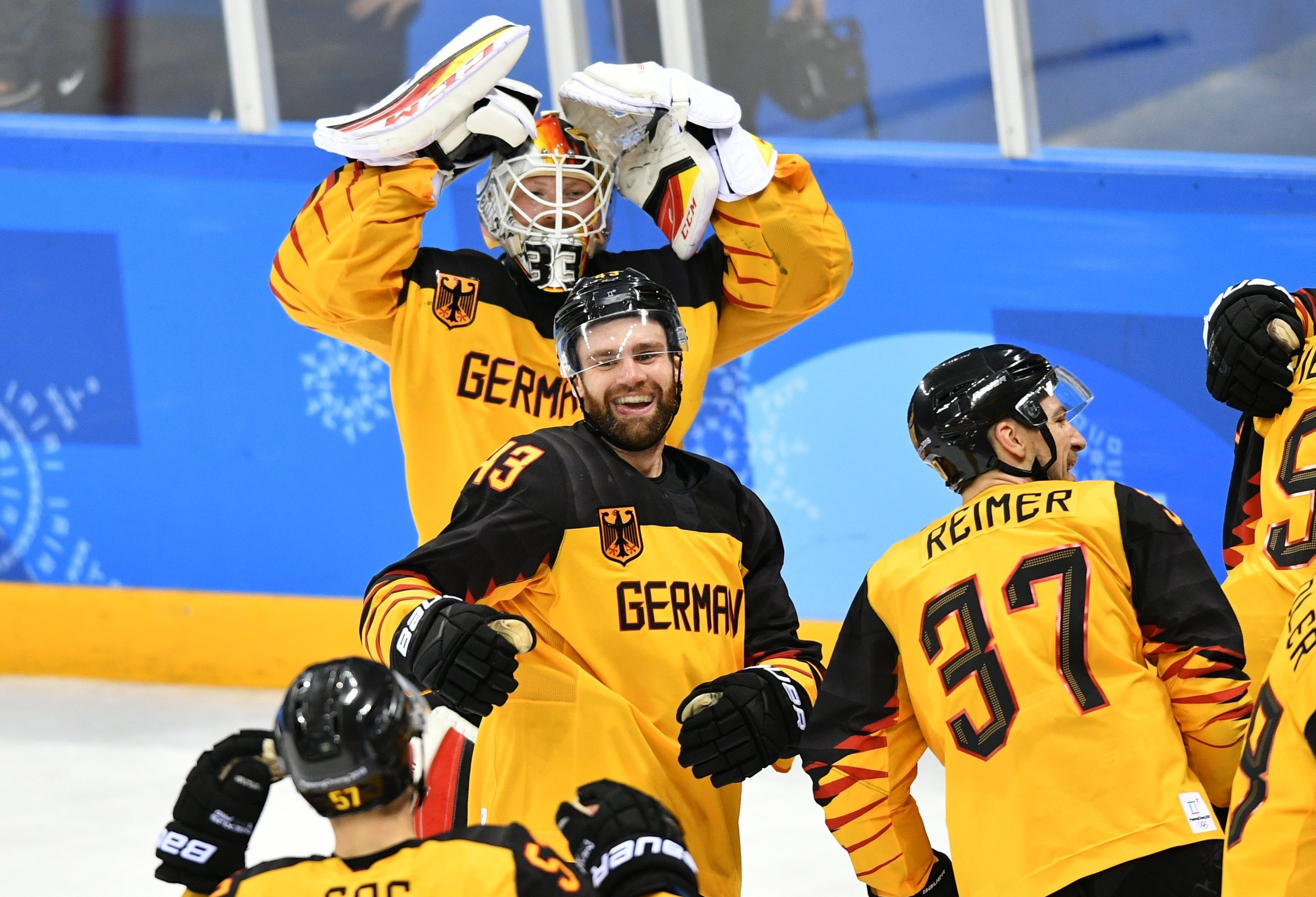 Germany's hockey players celebrate their victory in the semifinals between the Canada and Germany national teams in the men's ice hockey tournament, at the XXIII Olympic Winter Games