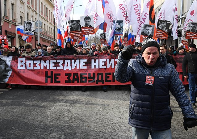 Participants in the march, held in Moscow to commemorate politician Boris Nemtsov
