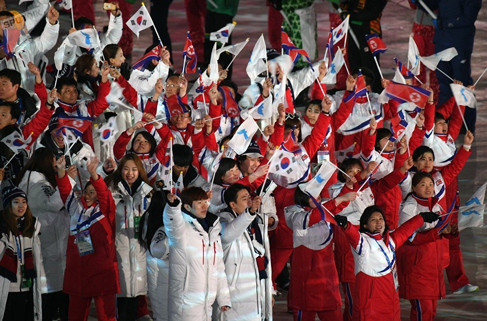 Athletes from the South Korean and DPRK teams marching together at the 2018 Winter Olympic Games closing ceremony in Pyeongchang