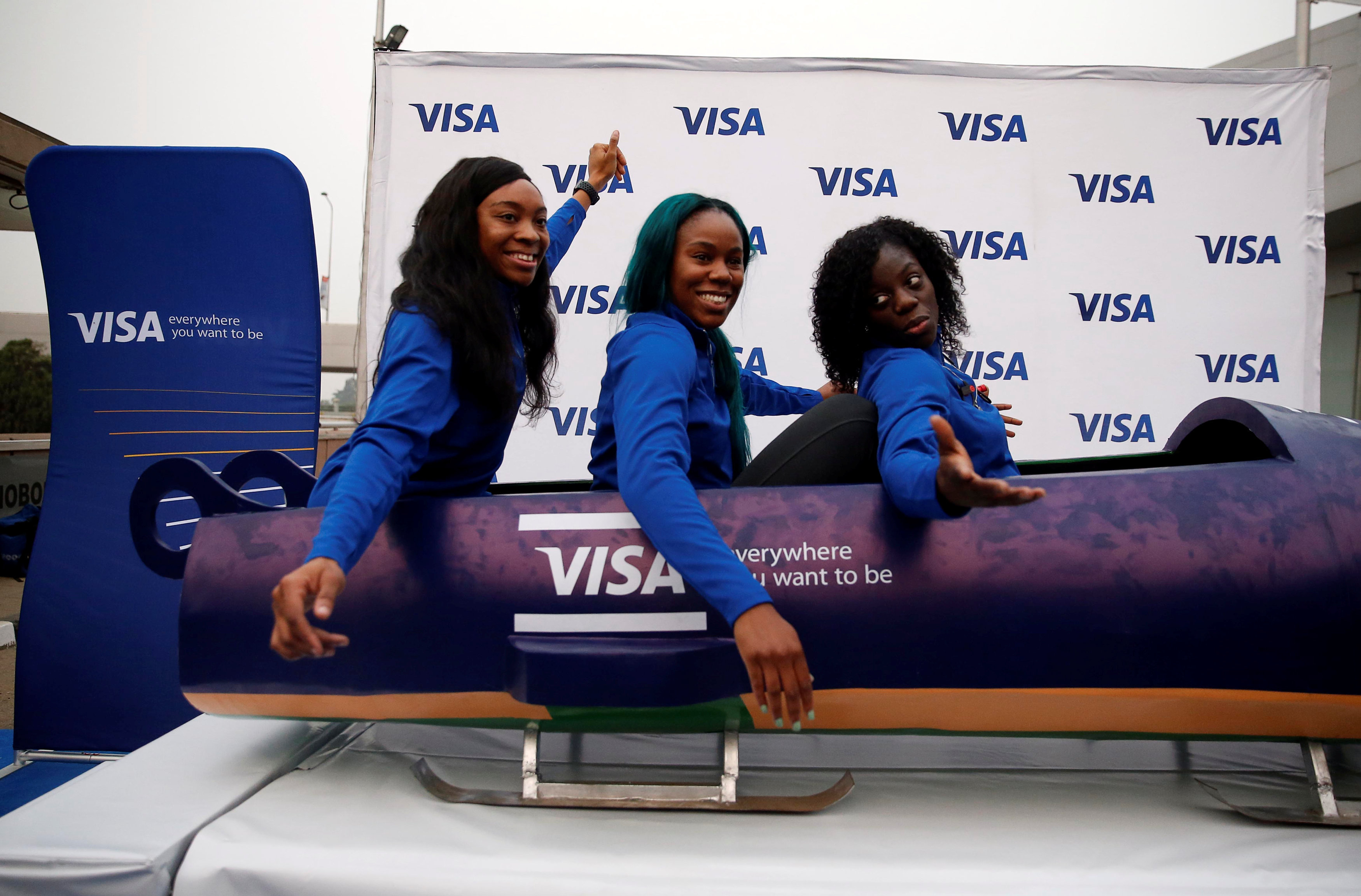 Nigerian Women's Bobsled Team Ngozi Onwumere, Akuoma Omeoga and Seun Adigun gesture in a bobsled upon their arrival in Lagos, Nigeria, as part of preparations ahead of the 2018 Pyeongchang Winter Olympic Games, February 1, 2018