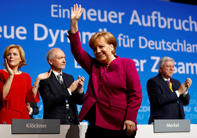 German Chancellor Angela Merkel receives applause after addressing a Christian Democratic Union (CDU) party congress in Berlin, Germany, February 26, 2018