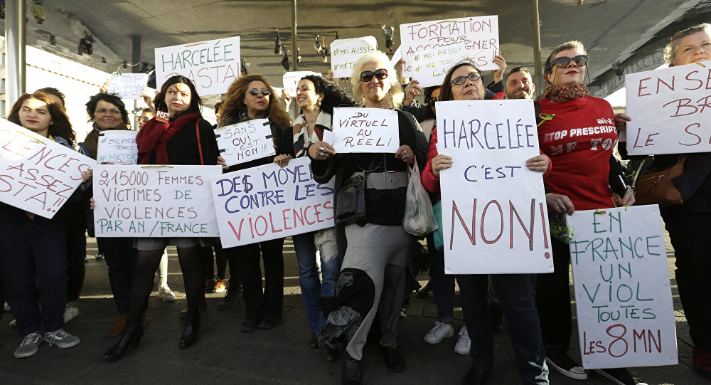 """Demonstrators hold placards reading Harassed it is no"""", """"In France, a rape every 8 minutes"""", """"21500 women victims of violence in France a year"""", """"Ways against the violence"""", """"Together let us break the silence, during a demonstration in Marseille, southern France, Sunday, Oct. 29, 2017"""
