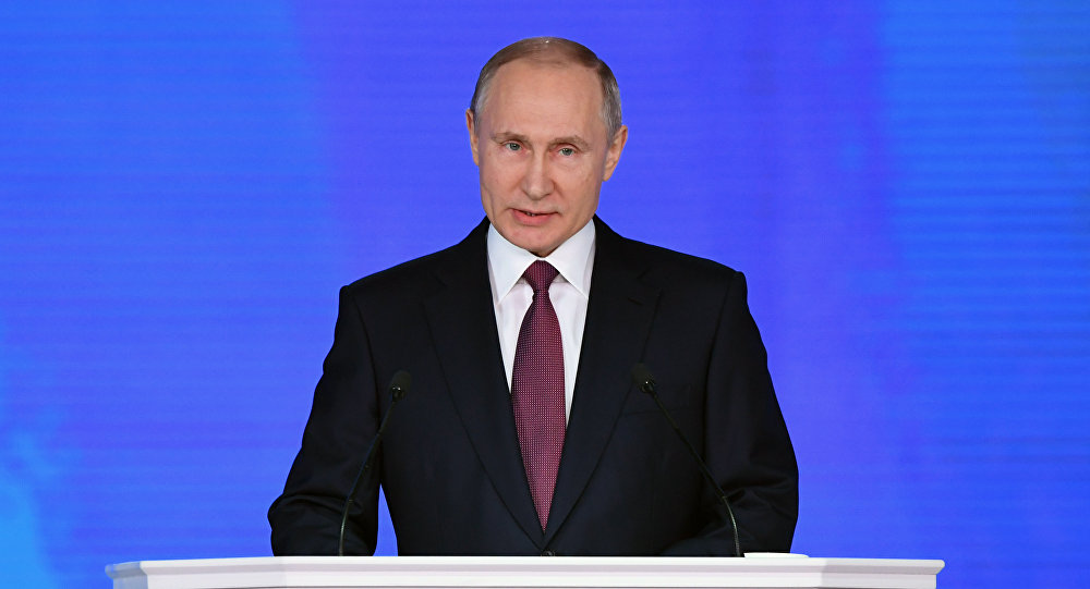 Russian President Vladimir Putin addresses the Federal Assembly at Moscow's Manezh exhibition centre on March 01, 2018