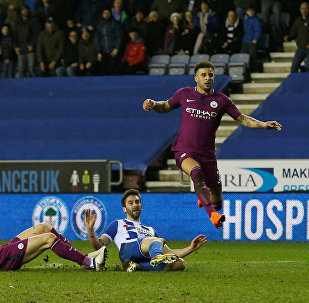 Soccer Football - FA Cup Fifth Round - Wigan Athletic vs Manchester City - DW Stadium, Wigan, Britain - February 19, 2018 Wigan Athletic's Will Grigg scores their first goal as Manchester City's Kyle Walker and Aymeric Laporte