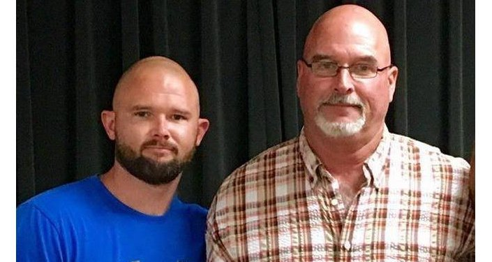 Gardner Kent Fraser and his father Ryan T Fraser at a retirement ceremony held by the Baker County Sheriff's Office on October 2, 2017
