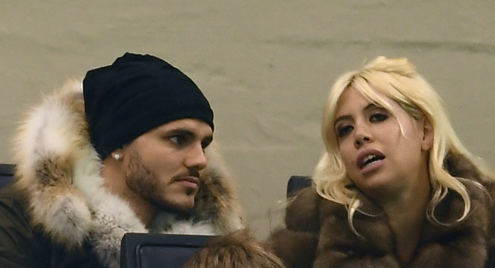 Inter Milan's Argentinian forward Mauro Emanuel Icardi (L) and his wife Wanda Nara look on during the Italian Serie A football match Inter Milan versus Crotone on February 3, 2018 at the 'Giuseppe Meazza' Stadium in Milan.