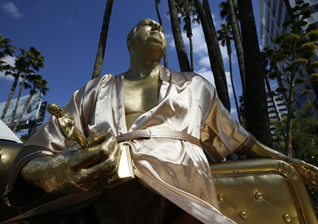 A golden statue of a bathrobe-clad Harvey Weinstein, seated almost regally atop a couch holding a fake Oscar Statuette, takes up temporary sidewalk residence four days before the Oscars on Hollywood Blvd. in Los Angeles Thursday, March 1, 2018.