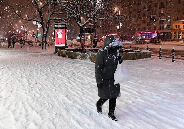 A picture taken on February 5, 2018 shows a pedestrian walking on street covered with snow in the Polish capital Warsaw