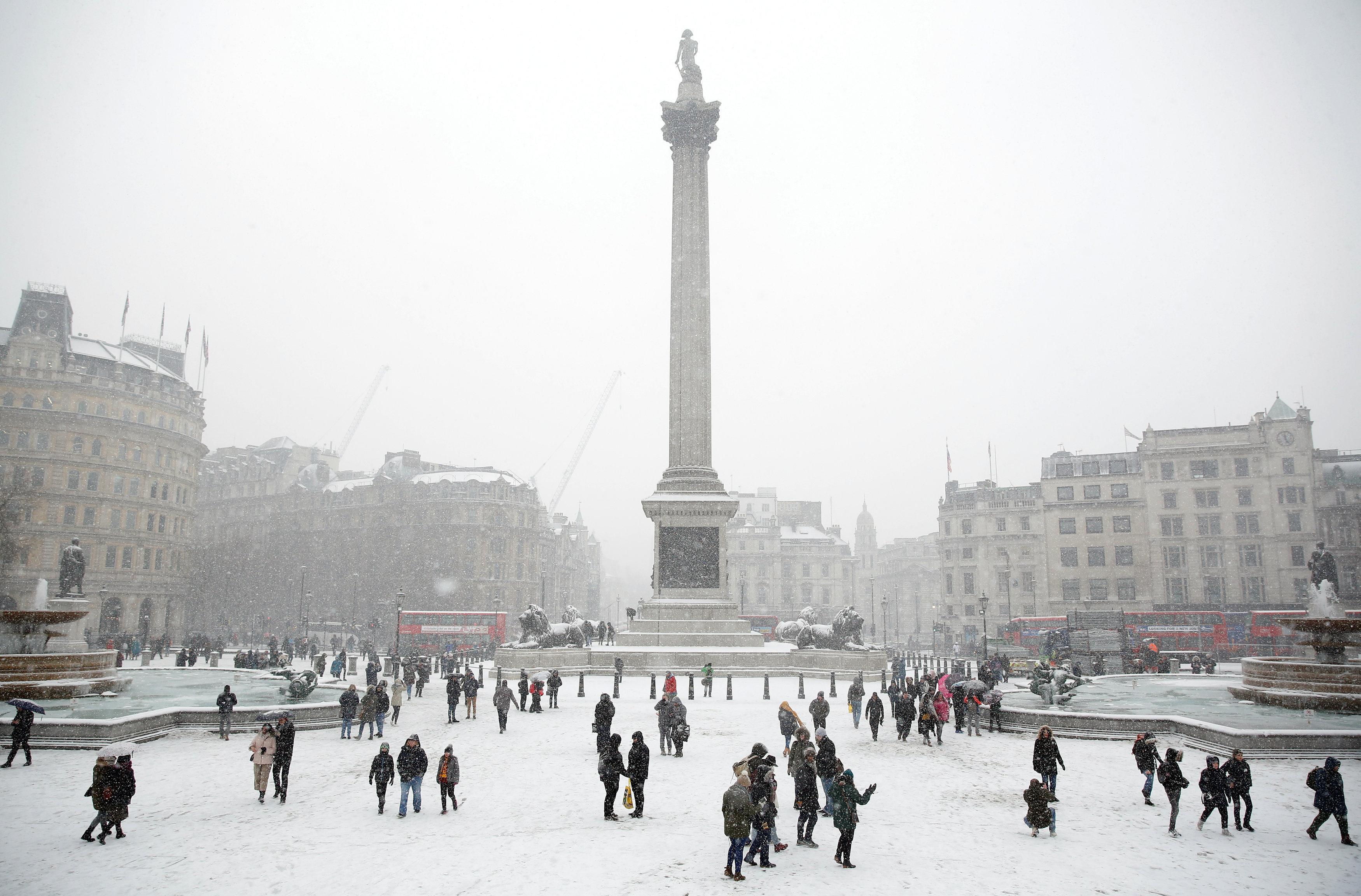 Visitors walk in the snow in Trafalgar Square, in central London, Britain March 2, 2018