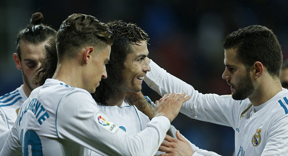 Real Madrid's Cristiano Ronaldo, centret, celebrates with teammates after scoring his side's third goal against Getafe during the Spanish La Liga soccer match between Real Madrid and Getafe at the Santiago Bernabeu stadium in Madrid, Saturday, March 3, 2018