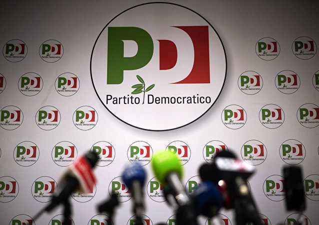 Microphones are set up at the the Democratic Party headquarters, in Rome, Sunday, March 4, 2018