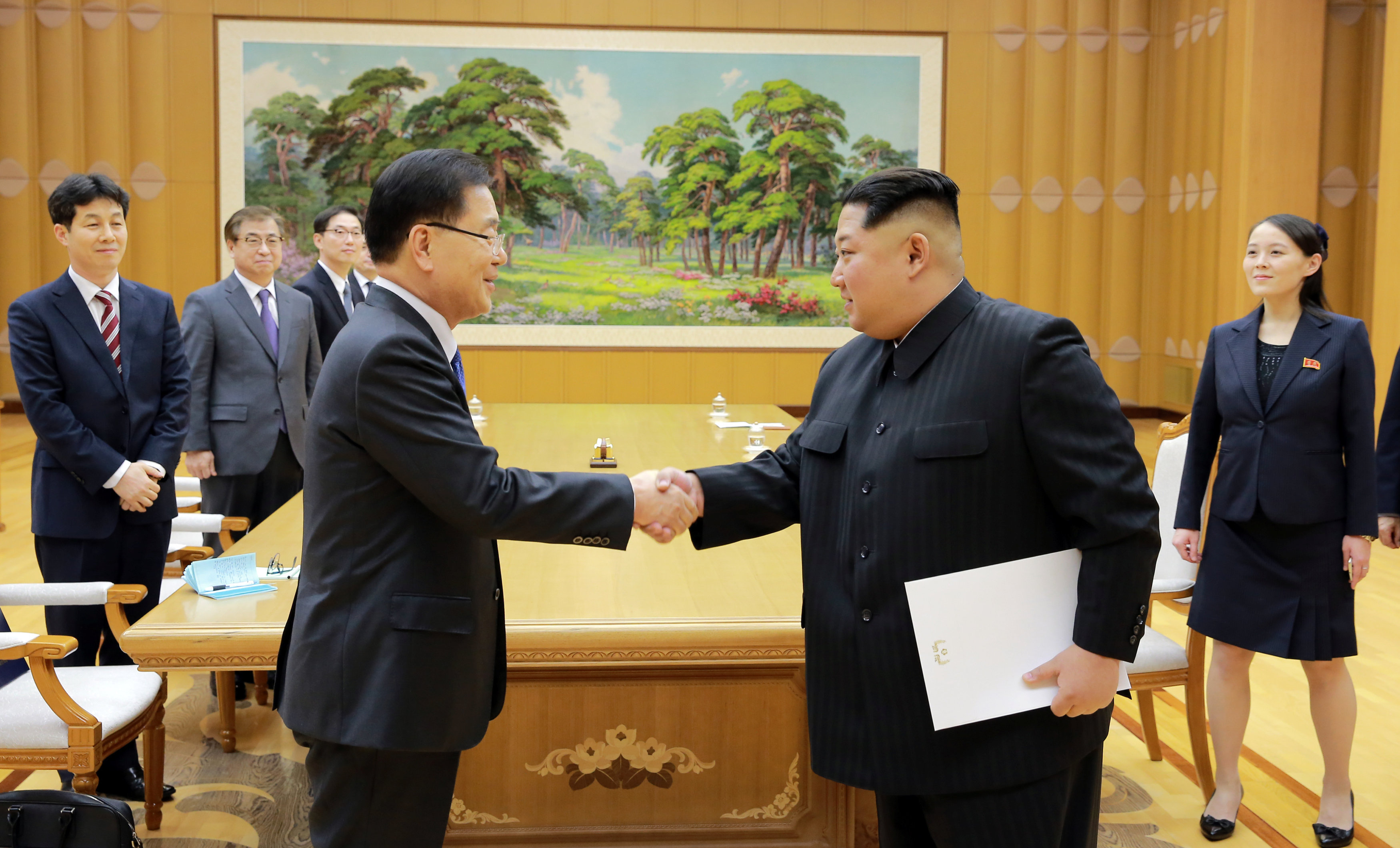 North Korean leader Kim Jong Un greets Chung Eui-yong, head of the presidential National Security Office, in Pyongyang, North Korea, March 6, 2018