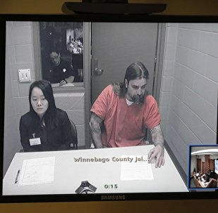 Brian Flatoff, wearing an orange prison jumpsuit, is pictured on a videolink during a preliminary hearing