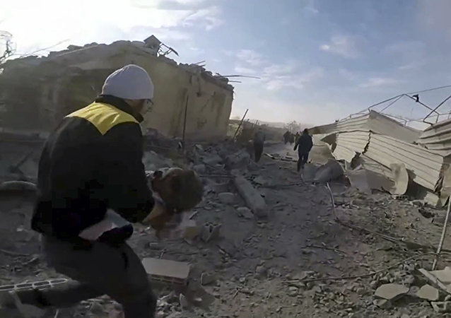 This frame grab from video released on Thursday, March. 1, 2018 by the Syrian Civil Defense White Helmets, which has been authenticated based on its contents and other AP reporting, shows a member of the Syrian Civil Defense group running as he holds a child who was wounded during airstrikes and shelling by Syrian government forces in the eastern Ghouta region near Damascus, Syria