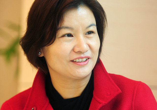 This picture taken on March 12, 2015 shows Zhou Qunfei, chairwoman and president of Hunan-based Lens Technology, during an interview in Changsha, central China's Hunan province