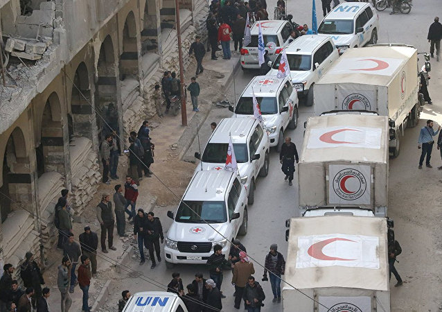 Trucks from Syrian Red Crescent and humanitarian partners are seen in Ghouta, Syria, March 5, 2018 in this picture obtained from social media