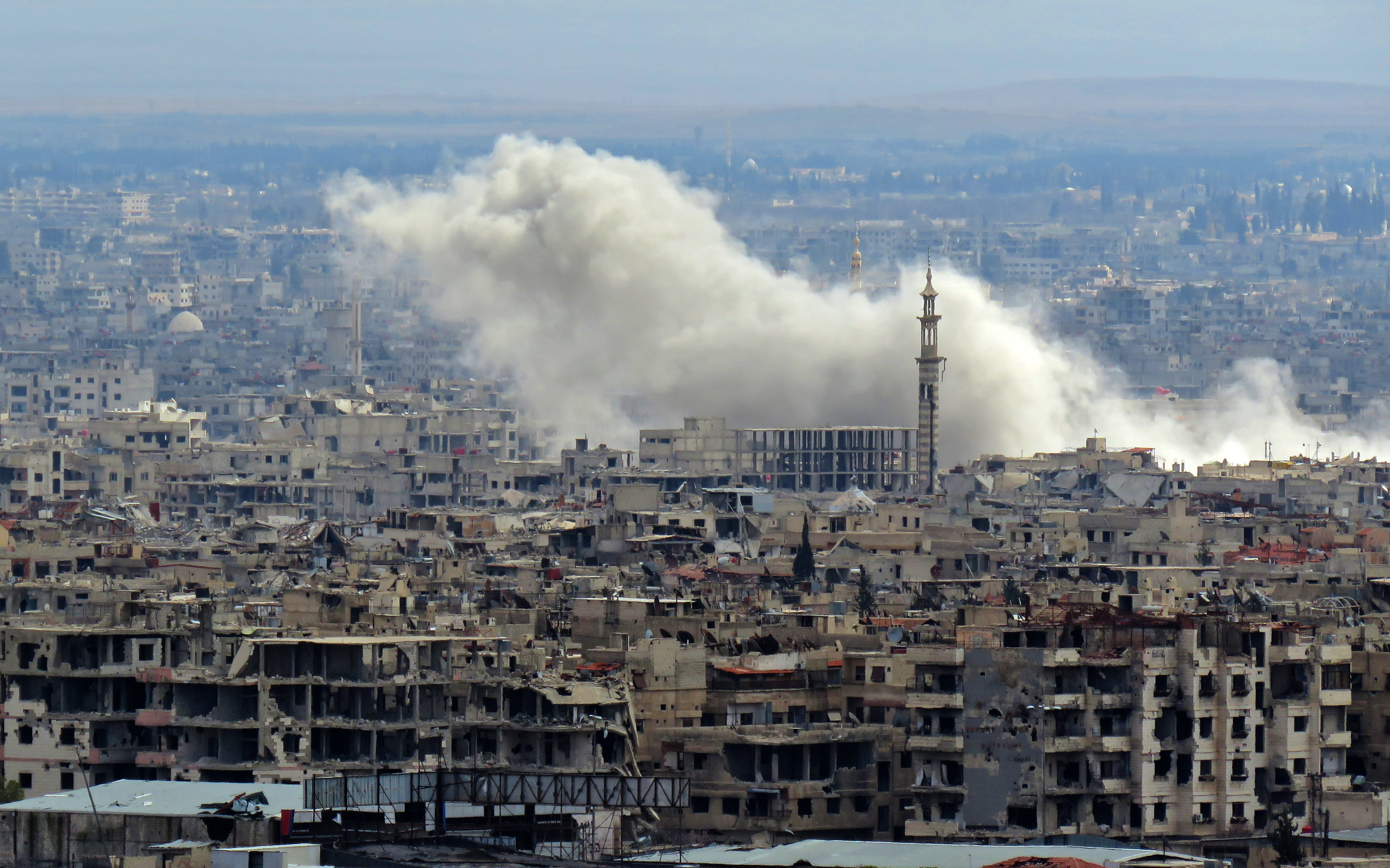 Aid convoy delivers food in Ghouta despite bombardment
