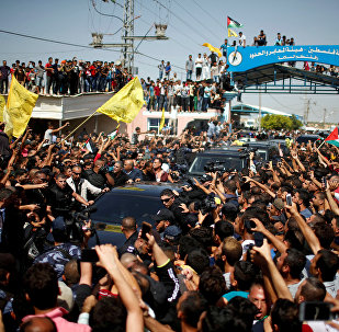 People gather as the convoy of Palestinian Prime Minister Rami Hamdallah and his government ministers arrive, in the northern Gaza Strip October 2, 2017