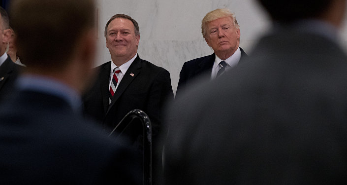President Donald Trump, accompanied by CIA Director-designate Rep. Michael Pompeo, left, waits to speak at the Central Intelligence Agency in Langley, Va., Saturday, Jan. 21, 2017