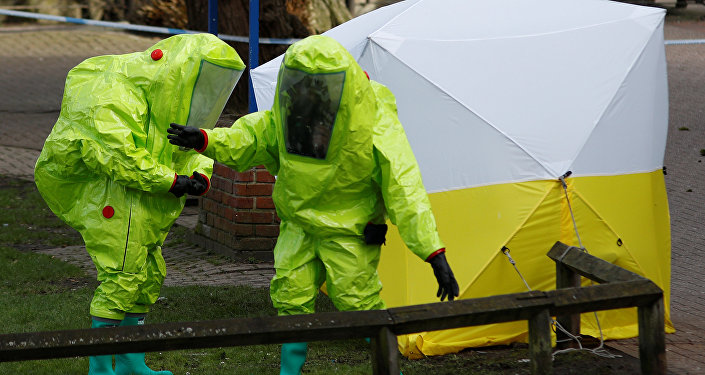 The forensic tent, covering the bench where Sergei Skripal and his daughter Yulia were found, is repositioned by officials in protective suits in the centre of Salisbury, Britain, March 8, 2018