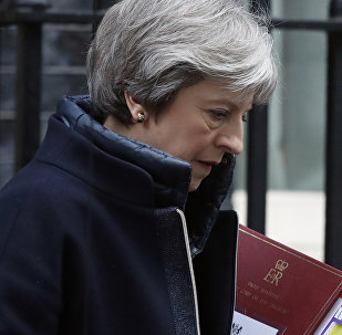 Britain's Prime Minister Theresa May leaves 10 Downing Street to attend the weekly Prime Minister's Questions session, in parliament in London, Wednesday, March 14, 2018