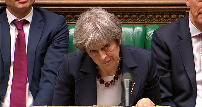 Britain's Prime Minister Theresa May reacts as the leader of the Labour Party Jeremy Corbyn responds to her address to the House of Commons on her government's reaction to the poisoning of former Russian intelligence officer Sergei Skripal and his daughter Yulia in Salisbury, in London, March 14, 2018