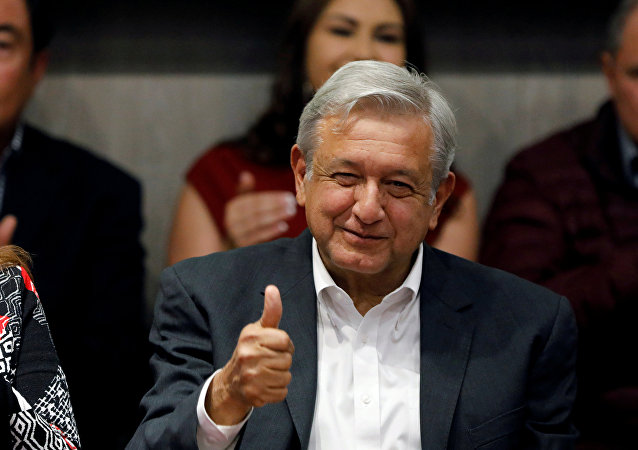 FILE PHOTO: Andres Manuel Lopez Obrador, presidential candidate of the National Regeneration Movement (MORENA) gives a thumbs up to members of Partido del Trabajo (Labor Party), in Mexico City, Mexico February 19, 2018