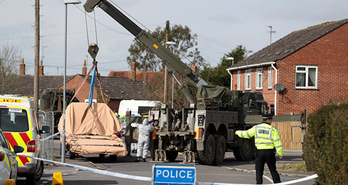 Soldiers wearing protective clothing prepare to lift tow truck in Hyde Road, Gillingham, Dorset, England as the investigation into the suspected nerve agent attack on Russian double agent Sergei Skripal continues Wednesday March 14, 2018