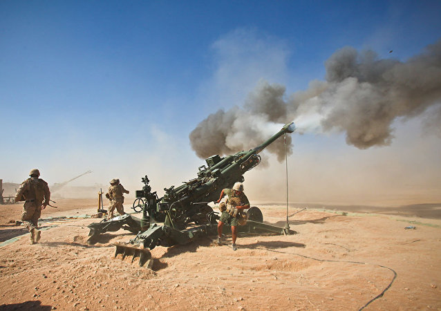 Marines with Charlie Battery, 1st Battalion, 12th Marine Regiment, fire an M982 Excalibur round from an M777 howitzer during a recent fire support mission
