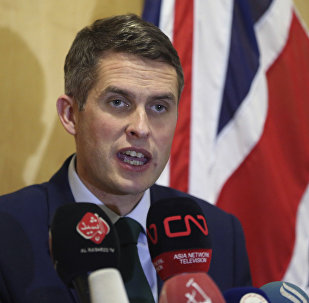In this Thursday, Jan. 4, 2018 Picture Britain's Defense Secretary Gavin Williamson holds a news conference in British embassy in Baghdad, Iraq.