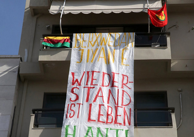 A banner reading Resistance is life, solidarity to Afrin hangs at the German Consulate in Heraklion, Crete Island on March 16, 2018, after a group of demonstrators occupied the building