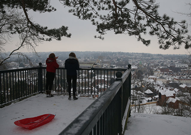 Residents look out over the snow covered town of Winchester in south west England on March 2, 2018