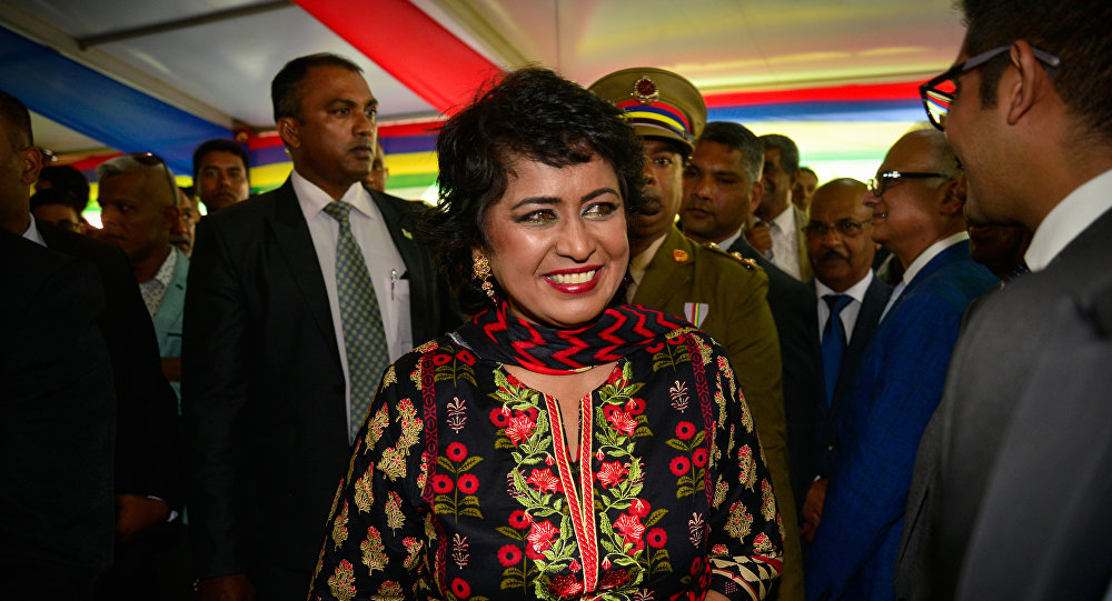 Mauritian President Ameenah Gurib-Fakim (C) greets guests during the annual garden party for the celebration of Independence at the State House in Reduit in Mauritius, on March 13, 2018