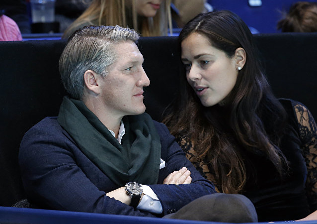 German footballer Bastian Schweinsteiger and wife Ana Ivanovic chat during the ATP World Tour Finals singles final tennis match between Andy Murray of Britain and Novak Djokovic of Serbia at the O2 Arena in London, Sunday, Nov. 20, 2016
