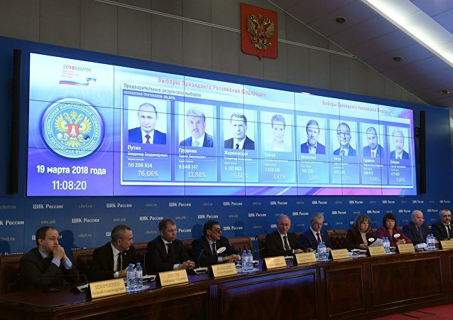 Preliminary results of the Russian presidential election shown on a screen at the information center of the Russian Central Election Commission. Fourth right: Ella Pamfilova, chairperson of the Russian Central Election Commission
