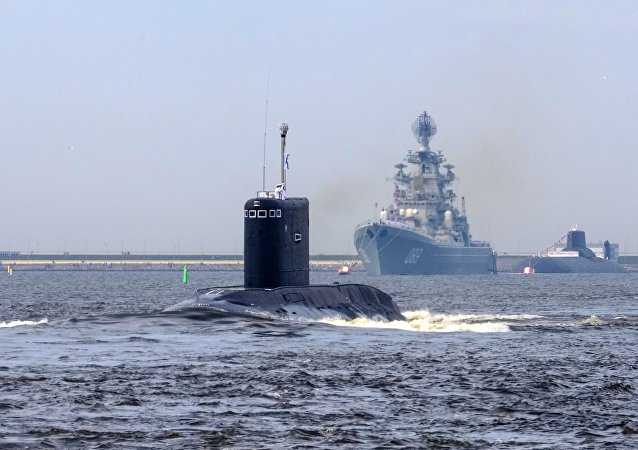 From left: the Kolpino diesel submarine, the Pyotr Veliky nuclear-powered guided-missile heavy cruiser, and the Dmitry Donskoi nuclear-powered ballistic missile submarine during the final rehearsal of the naval parade to celebrate Russian Navy Day in Kronstadt