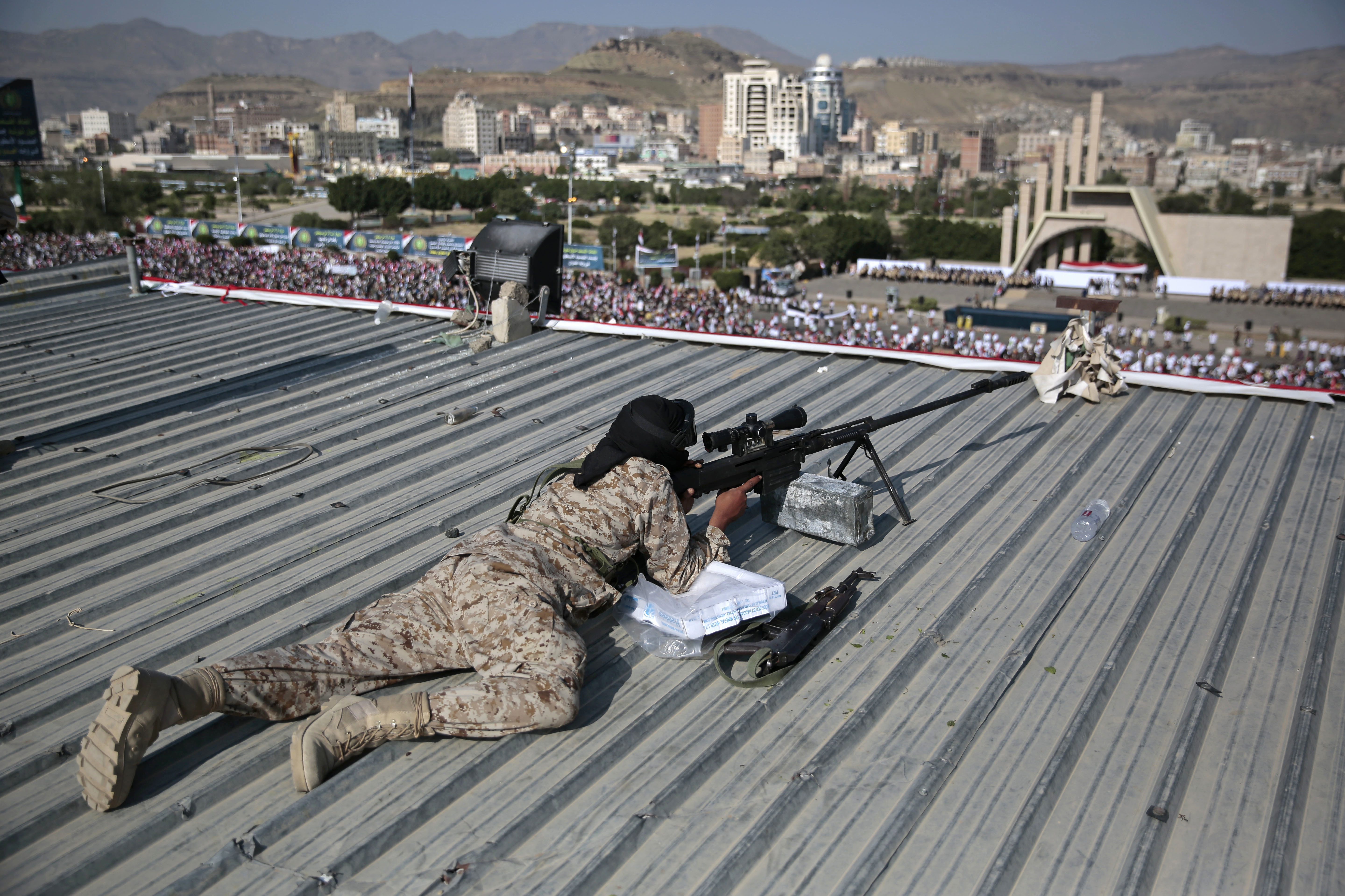 A Houthi Shiite sniper keeps watch over a rally to mark the third anniversary of the Houthis' takeover of the Yemeni capital, in Sanaa