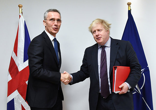 NATO Secretary-General Jens Stoltenberg poses with British Foreign Secretary Boris Johnson at the Alliance headquarters in Brussels, Belgium