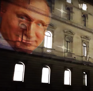 Putin on the front of the Foreign Office Building in London.