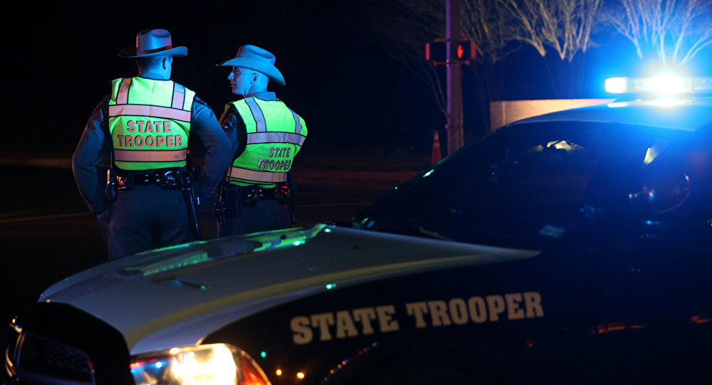Texas state troopers keep watch at a checkpoint as nearby law enforcement personnel investigate an incident that they said involved an incendiary device in the 9800 block of Brodie Lane in Austin, Texas, U.S