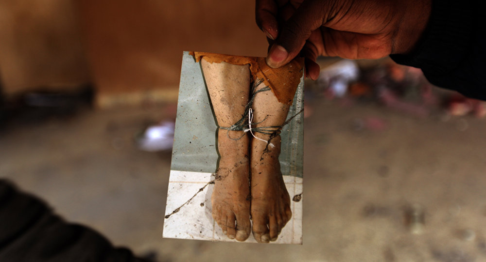 A Libyan protester shows a picture found in the ransacked headquarters of the judiciary police in Benghazi. (File)