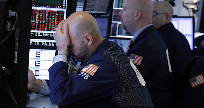 Trader Fred DeMarco, left, works with colleagues in a booth on the floor of the New York Stock Exchange, Thursday, March 22, 2018. Stocks are falling sharply and bond prices are climbing after the Trump administration moved to place tariffs on some goods imported from China and restrict Chinese investment.