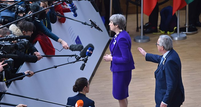 European Commission President Jean-Claude Juncker greets Britain's Prime Minister Theresa May at a European Union leaders summit in Brussels, Belgium, March 22, 2018.
