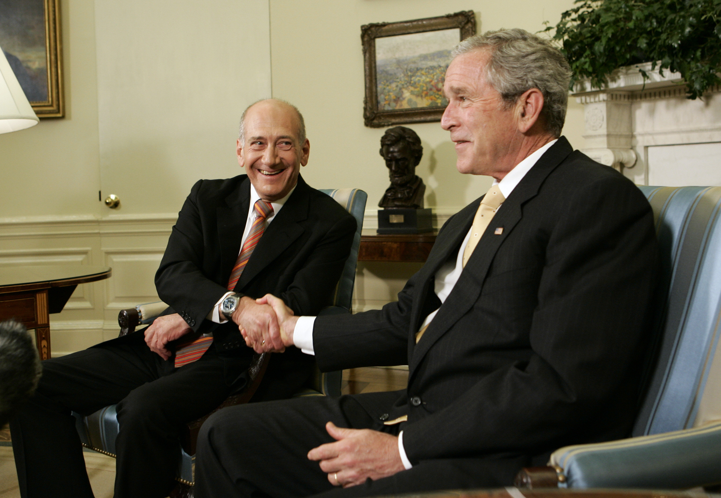 President Bush, right, shakes hands with Israeli Prime Minister Ehud Olmert, Wednesday, June 4, 2008, in the Oval Office of the White House