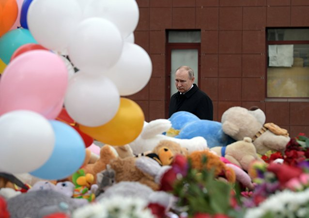 Russian President Vladimir Putin lays flowers at an impromptu memorial near the Zimnyaya Vishnya shopping mall in Kemerovo to honor those killed in the shopping mall fire.