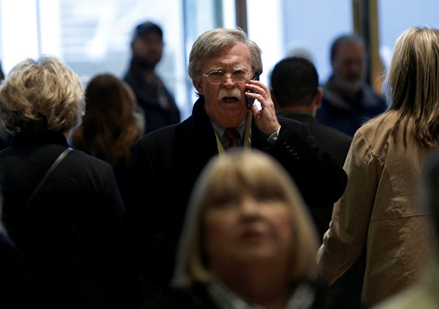 Former U.S. Ambassador to the United Nations John Bolton speaks on a mobile phone as he arrives for a meeting with U.S. President-elect Donald Trump at Trump Tower in New York, U.S., December 2, 2016