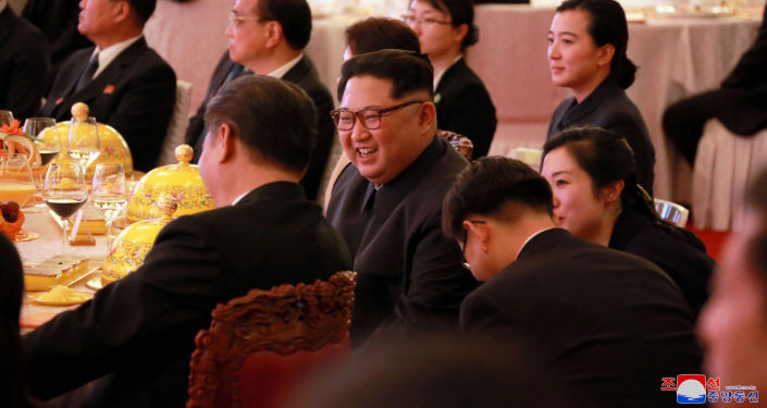 North Korean leader Kim Jong Un smiles during a banquet, as he paid an unofficial visit to Beijing, China, in this undated photo released by North Korea's Korean Central News Agency (KCNA) in Pyongyang March 28, 2018.