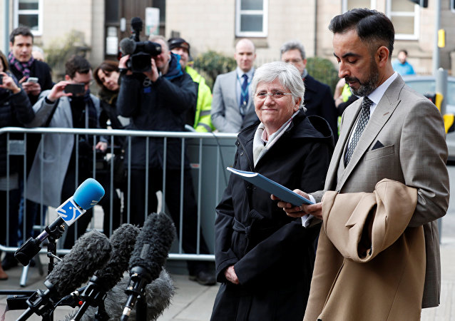 Catalunya's former education minister Carla Ponsati arrives with her lawyer Aamer Anwar to hand herself in at a police station in Edinburgh, Scotland, Britain, March 28, 2018